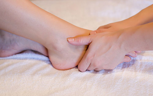 Amyotrophic lateral sclerosis reflexology foot massage for relief